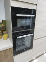 Fitted Kitchen Comprising Siemens HB6B80C0 Steaming Ovens and Type CTE533W Coffee Machine (Microwave, Conventional Oven and Plate Warmer Excluded), Siemens 4 Pan Ceramic Hob, Caple 6 Tier Wine Bottle Chiller, Siemens Type KULL14A Integrated Under Counter - 6